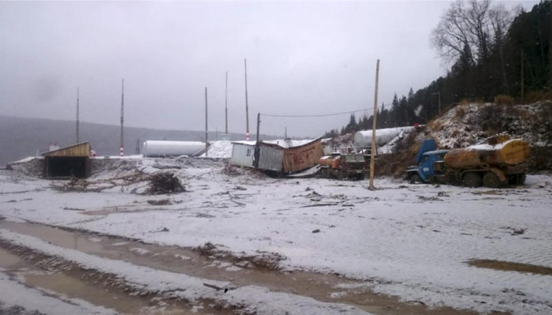 In this image made from video provided by Russian Emergency Situations Ministry press service, a view after the collapse during heavy rain occurred near the village of Shchetinkino, in the Krasnoyarsk region about 3,400 kilometers (2,100 miles) east of Moscow, Russia, Saturday, Oct. 19, 2019. Russian emergency officials say at least 15 people are dead after a dam at a Siberian gold mine collapsed and water flooded two workers' dormitories,13 people were unaccounted for, Russian news agencies reported. (Russian Ministry of Emergency Situations press service via AP)