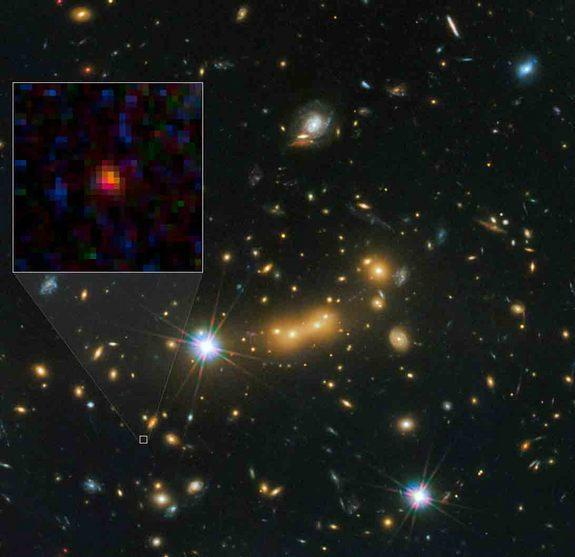 The galaxy MACS0647-JD (inset) appears very young and is only a fraction of the size of our own Milky Way. The galaxy is about 13.3 billion light-years from Earth, the farthest galaxy yet known, and formed 420 million years after the Big Bang.