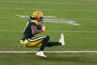 Green Bay Packers' Davante Adams catches a touchdown pass from Aaron Rodgers during the first half of an NFL divisional playoff football game against the Los Angeles Rams, Saturday, Jan. 16, 2021, in Green Bay, Wis. (AP Photo/Matt Ludtke)