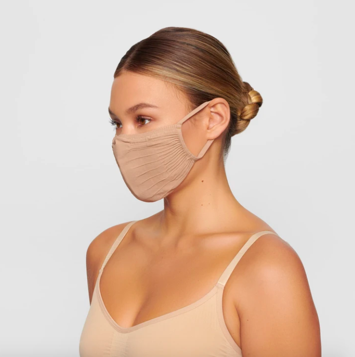 Adult Seamless Knit Face Mask in Clay. Image via skims.com
