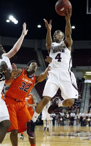 Mississippi State guard Trivante Bloodman (4) attempts a shot past the defense of Auburn forward Noel Johnson (32) in the first half of their NCAA college basketball game in Starkville, Miss., Saturday, March 9, 2013. (AP Photo/Rogelio V. Solis)