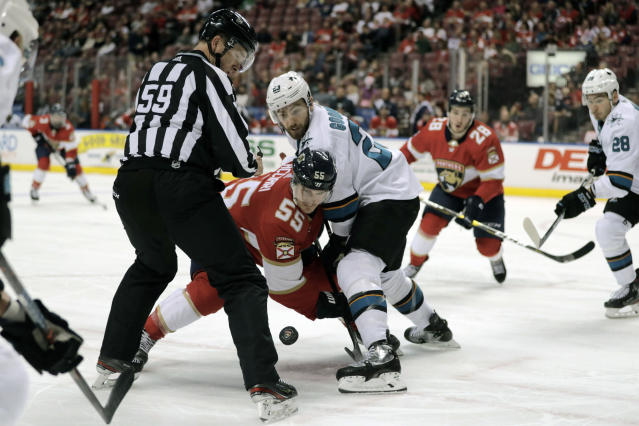 Florida Panthers' Noel Acciari (55) and San Jose Sharks' Barclay Goodrow, right, face off during the second period of an NHL hockey game, Sunday, Dec. 8, 2019, in Sunrise, Fla. (AP Photo/Luis M. Alvarez)
