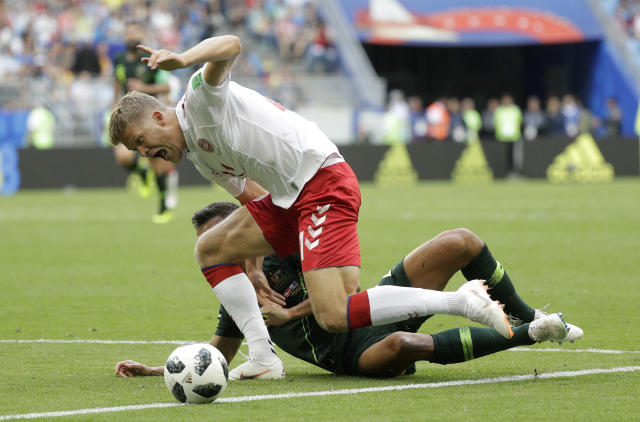 Denmark's Andreas Cornelius, right, shouts out after a challenge from Australia's Trent Sainsbury during the group C match between Denmark and Australia at the 2018 soccer World Cup in the Samara Arena in Samara, Russia, Thursday, June 21, 2018. (AP Photo/Gregorio Borgia)