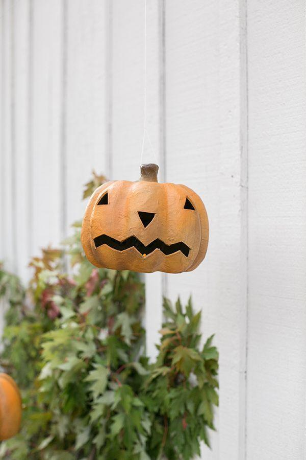 """<p>Not only do these hanging Jack-o'-lanterns look awesome, but they also glow! Battery-operated tea lights make them a cinch to bring to life.</p><p><strong>Get the tutorial at <a href=""""https://sugarandcharm.com/a-charming-and-traditional-halloween-party"""" rel=""""nofollow noopener"""" target=""""_blank"""" data-ylk=""""slk:Sugar and Charm"""" class=""""link rapid-noclick-resp"""">Sugar and Charm</a>.</strong></p><p><a class=""""link rapid-noclick-resp"""" href=""""https://go.redirectingat.com?id=74968X1596630&url=https%3A%2F%2Fwww.walmart.com%2Fip%2FActiva-Fast-Mache-Instant-Paper-Mache-2-lb%2F24419072&sref=https%3A%2F%2Fwww.thepioneerwoman.com%2Fholidays-celebrations%2Fg32894423%2Foutdoor-halloween-decorations%2F"""" rel=""""nofollow noopener"""" target=""""_blank"""" data-ylk=""""slk:SHOP PAPIER-MÂCHÉ""""> SHOP PAPIER-MÂCHÉ</a></p>"""