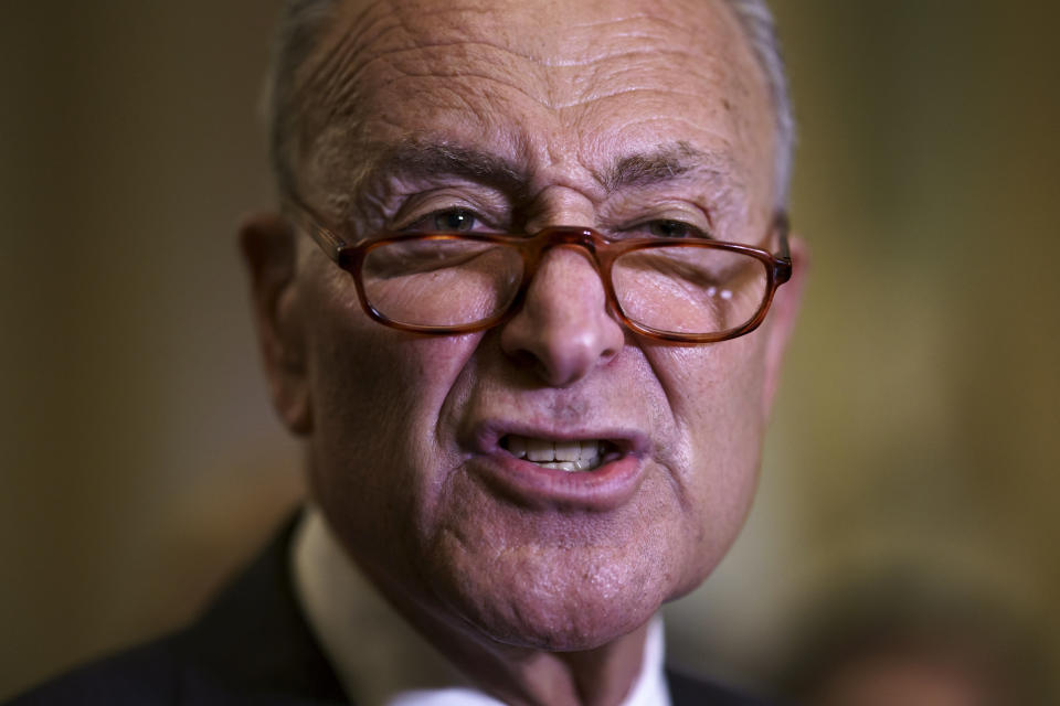 Senate Majority Leader Chuck Schumer, D-N.Y., criticizes Republicans as he speaks to reporters after a weekly policy meeting, at the Capitol in Washington, Tuesday, Sept. 21, 2021. (AP Photo/J. Scott Applewhite)