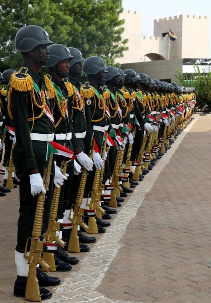 Sudanese honour guards in the capital, Khartoum, await the arrival of Eritrea's military chief of staff on Monday.