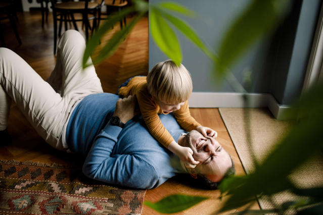 Children whose fathers play with them from an early age could see benefits to their behaviour. (Getty Images)