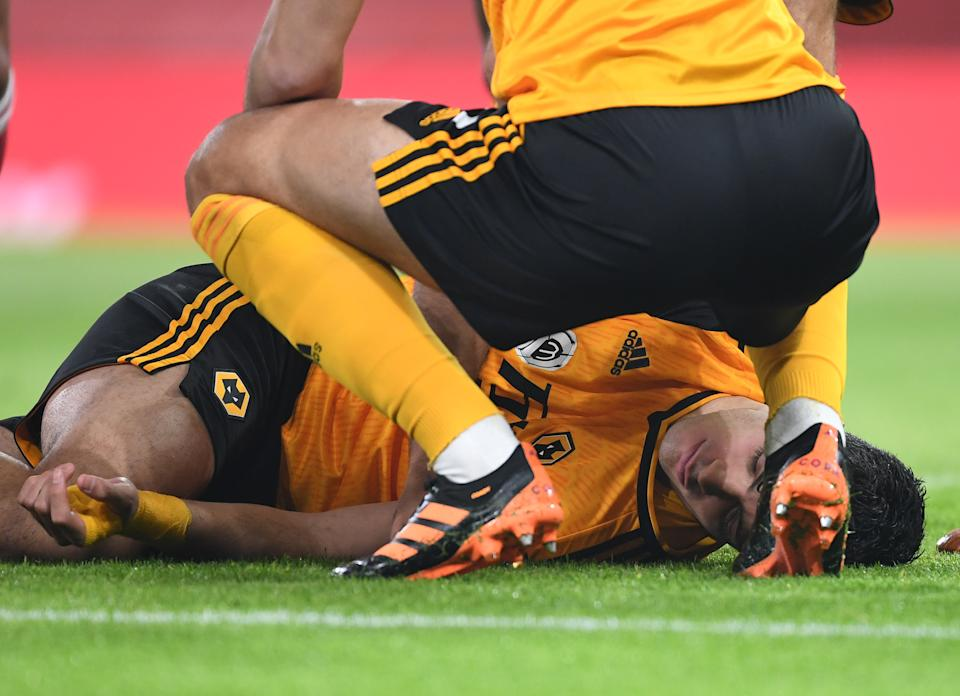 LONDON, ENGLAND - NOVEMBER 29: Raul Jimenez of Wolves injured on the pitch during the Premier League match between Arsenal and Wolverhampton Wanderers at Emirates Stadium on November 29, 2020 in London, England. Sporting stadiums around the UK remain under strict restrictions due to the Coronavirus Pandemic as Government social distancing laws prohibit fans inside venues resulting in games being played behind closed doors. (Photo by David Price/Arsenal FC via Getty Images)