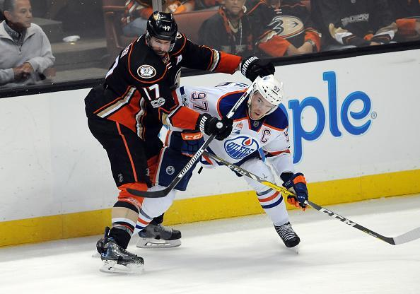 "ANAHEIM, CA – MAY 05: <a class=""link rapid-noclick-resp"" href=""/nhl/teams/edm/"" data-ylk=""slk:Edmonton Oilers"">Edmonton Oilers</a> captain Conner McDavid (97) and <a class=""link rapid-noclick-resp"" href=""/nhl/teams/ana/"" data-ylk=""slk:Anaheim Ducks"">Anaheim Ducks</a> center <a class=""link rapid-noclick-resp"" href=""/nhl/players/3331/"" data-ylk=""slk:Ryan Kesler"">Ryan Kesler</a> (17) in action next to the boards during in first overtime of game 5 of the second round of the 2017 Stanley Cup Playoffs against the Anaheim Ducks, on May 5, 2017, played at the Honda Center in Anaheim, CA. (Photo by John Cordes/Icon Sportswire via Getty Images)"