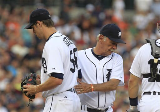Detroit Tigers starting pitcher Doug Fister is replaced by manager Jim Leyland during the fifth inning of a baseball game against the Minnesota Twins in Detroit, Monday, July 2, 2012. (AP Photo/Carlos Osorio)