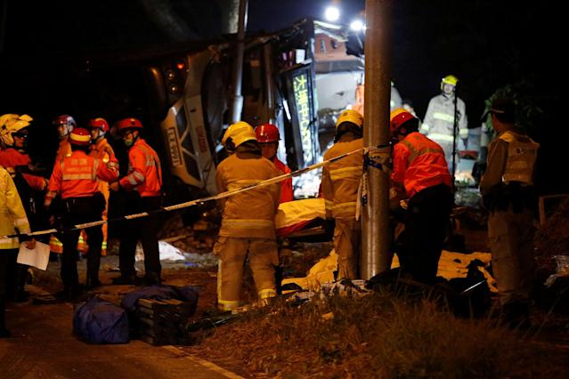 <p>Rescuers work near a crashed bus in Hong Kong, China, Feb. 10, 2018. (Photo: Bobby Yip/Reuters) </p>