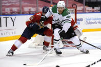 Dallas Stars center Joe Pavelski (16) goes for the puck as Florida Panthers defenseman Radko Gudas (7) defends during the third period of an NHL hockey game, Monday, Feb. 22, 2021, in Sunrise, Fla. The Panthers won 3-1. (AP Photo/Lynne Sladky)