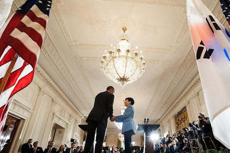 South Korean President Park Geun-hye (R) attends a press conference with US President Barack Obama in the East Room of the White House on October 16, 2015 in Washington, DC (AFP Photo/Brendan Smialowski)