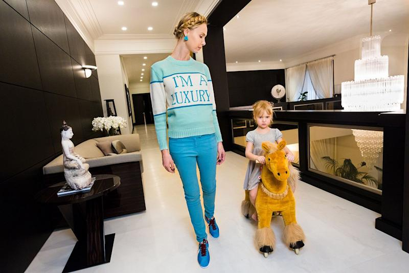 Ilona at home with her daughter, Michelle, 4, in Moscow. Ilona's sweater was produced for her in a custom color by her friend Andrey Artyomov, whose Walk of Shame fashion line is popular among the wives of oligarchs.