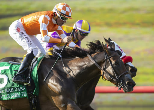 In a photo provided by Benoit Photo, Fatale Bere and jockey Kent Desormeaux, outside, outleg Ollie's Candy, inside, with Tyler Baze, to win the Grade I, $300,000 Del Mark Oak horse race Saturday, Aug. 18, 2018, at Del Mar Thoroughbred Club in Del Mar, Calif. (Benoit Photo via AP)