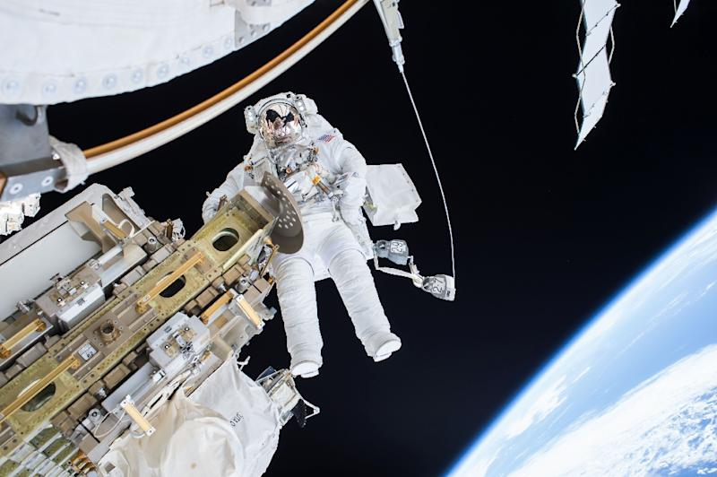An astronaut goes on a spacewalk outside the International Space Station, where he may soon be joined by tourists