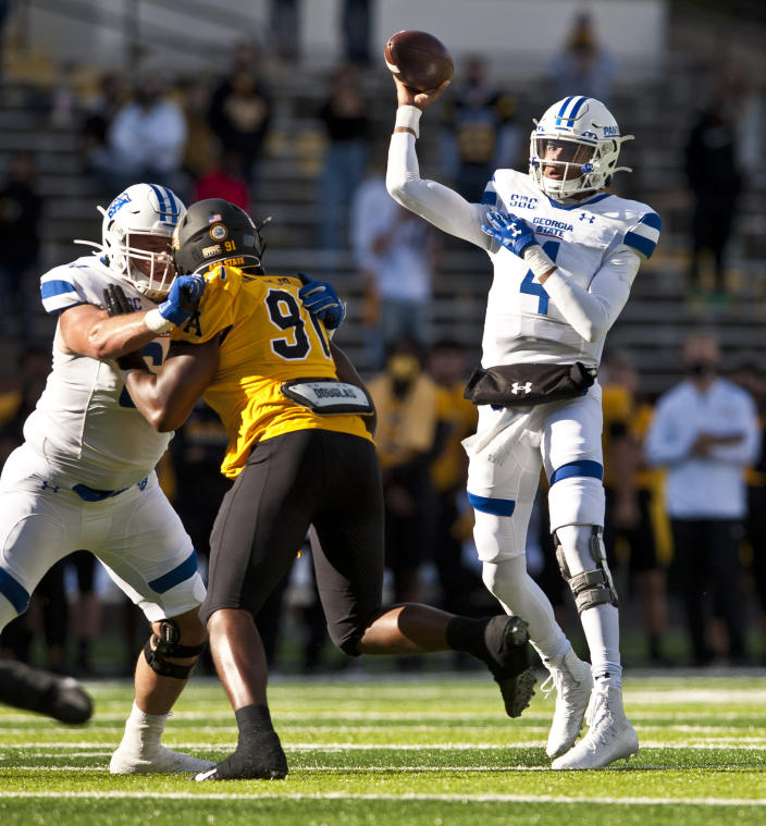 Georgia State quarterback Cornelious Brown IV throws in the first half during an NCAA football game, against Appalachian State Saturday, Nov. 14, 2020, in Boone, N.C. (Walt Unks/Winston-Salem Journal via AP)