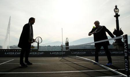 Bjorn Borg of Sweden returns the ball to Switzerland's Roger Federer (L) during a tennis session to promote the Laver Cup tennis tournament on a temporary court on the banks of Lake Geneva in Geneva, Switzerland February 8, 2019. REUTERS/Arnd Wiegmann