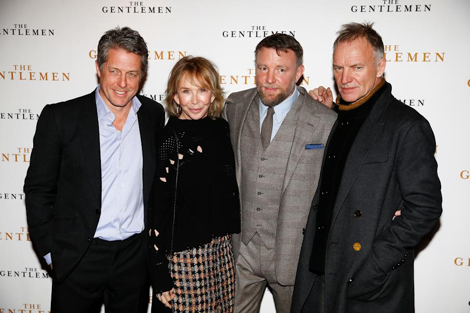 "Singer Sting and his wife Trudie Styler, actor Hugh Grant and director Guy Ritchie pose as they arrive for a special screening of ""The Gentlemen"" in London, Britain December 3, 2019. REUTERS/Henry Nicholls"