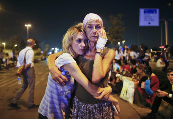 <p>Passengers embrace each other as they wait outside Istanbul's Ataturk airport, early Wednesday, June 29, 2016 following their evacuation after a blast. Suspected Islamic State group extremists have hit the international terminal of Istanbul's Ataturk airport, killing dozens of people and wounding many others, Turkish officials said Tuesday. Turkish authorities have banned distribution of images relating to the Ataturk airport attack within Turkey. (AP Photo/Emrah Gurel) </p>