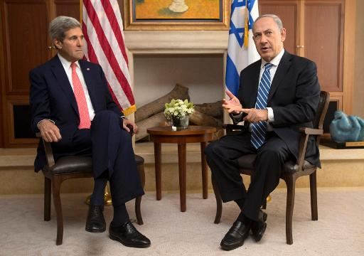 Israeli Prime Minister Benjamin Netanyahu (R) speaks near US Secretary of State John Kerry during a meeting on November 6, 2013 in Jerusalem
