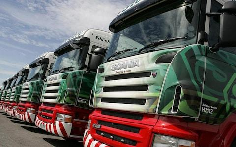 <span>The haulage and logistics company, known for its distinctive trucks, said it was suspending its listing on London's junior Aim market</span> <span>Credit: Eddie Stobart/PA </span>