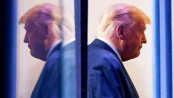 PHOTO: President Donald Trump is reflected as he departs after speaking about the 2020 U.S. presidential election results in the Brady Press Briefing Room at the White House, Nov. 5, 2020. (Carlos Barria/Reuters)