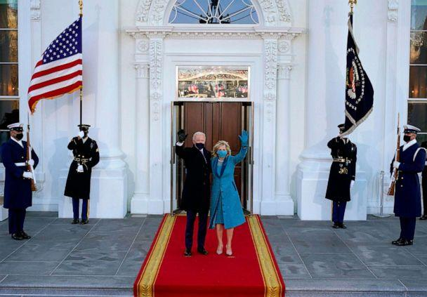 PHOTO: President Joe Biden and first lady Jill Biden wave as they arrive at the White House in Washington, D.C, after Biden and Harris were sworn in at the Capitol on Jan. 20, 2021. (Alex Brandon/POOL/AFP via Getty Images)