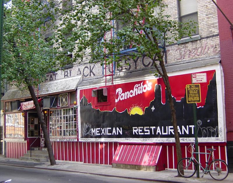 """In this undated photo provided by the Greenwich Village Society for Historic Preservation, an old sign for the Fat Black Pussycat Theater is shown on a site on Minetta St. in Manhattan. The location was taken over by Panchito's Restaurant in the 1970's and last week, Panchito's painted the sign bright red. The coffee bar had been a beatnik haven, where some claim a young Bob Dylan wrote """"Blowin' in the Wind"""".  (AP Photo/Greenwich Village Society for Historic Preservation)"""