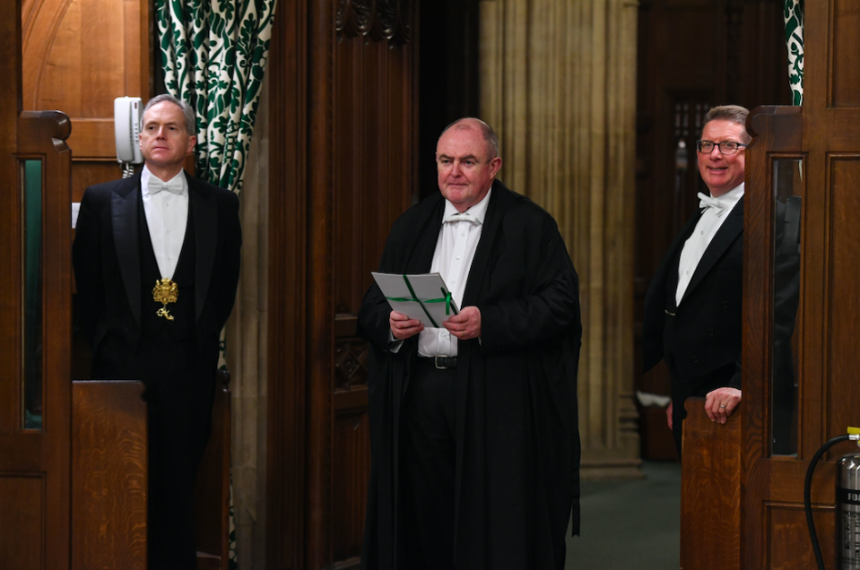The European Union (Withdrawal Agreement) Bill being carried between the two Houses of Parliament by the Clerk of Legislation Liam Lawrence Smyth (PA)