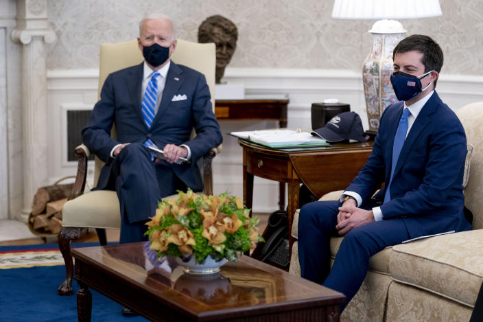 President Joe Biden and Transportation Secretary Pete Buttigieg, right, meet with Vice President Kamala Harris and members of the House of Representatives in the Oval Office of the White House in Washington, Thursday, March 4, 2021, on infrastructure. (AP Photo/Andrew Harnik)