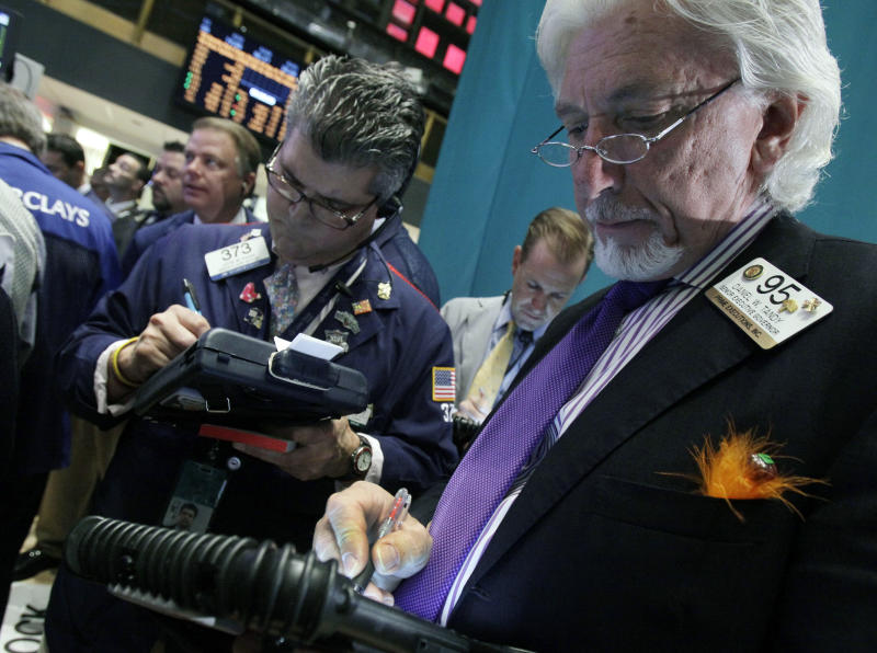Traders John Panin, left, and Dan Tandy, right, work on the floor of the New York Stock Exchange Wednesday, Oct. 3, 2012.Stocks are mostly higher in early trading on Wall Street Wednesday after a measure of private sector hiring came in better than economists were expecting. (AP Photo/Richard Drew)