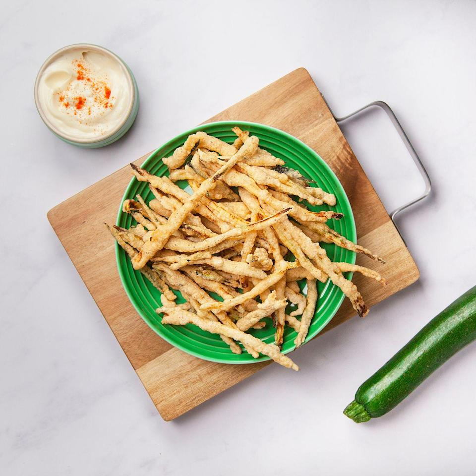 """<p>Crispy and moreish, these courgette fries are the perfect side dish.</p><p><strong>Recipe: <a href=""""http://www.goodhousekeeping.com/uk/food/recipes/a25915659/courgette-fries/"""" rel=""""nofollow noopener"""" target=""""_blank"""" data-ylk=""""slk:Courgette fries"""" class=""""link rapid-noclick-resp"""">Courgette fries</a></strong></p>"""