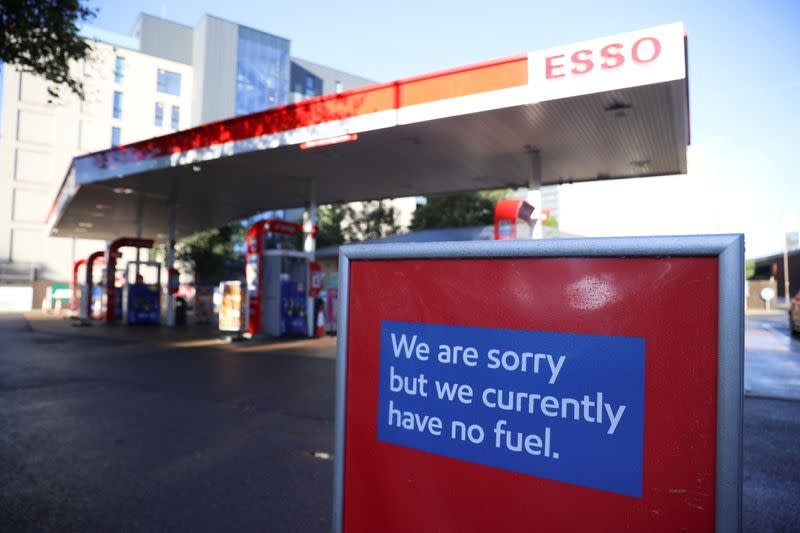 FILE PHOTO: A sign informing customers that fuel has run out is pictured at a Esso fuel station in London