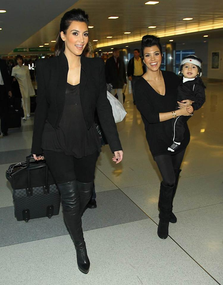"""The Kardashian sisters are always on the go, which means Kourtney's 1-year-old son Mason is always on the go, too! Brian Prahl/<a href=""""http://www.splashnewsonline.com/"""" target=""""new"""">Splash News</a> - November 30, 2010"""