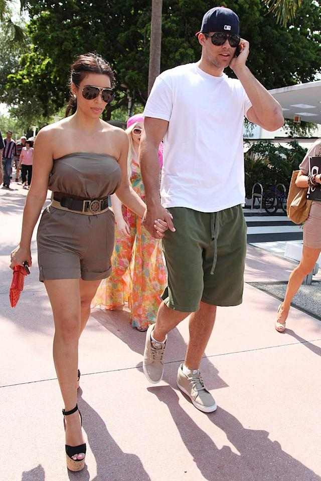 "MediaTakeOut reports rather bluntly that Kim Kardashian is ""knocked up."" The site even has photos of Kardashian sporting an obvious ""baby bump"" while out to dinner with boyfriend Kris Humphries. Plus, the blog notes that she ""didn't have a sip of alcohol"" during the meal. For how far along the reality star is, and when she and Humphries plan to officially announce the happy news, check out what Kardashian herself says on <a href=""http://www.gossipcop.com/kim-kardashian-pregnant-baby-bump-pics-photos-picture-photoshopped-belly/"" target=""new"">Gossip Cop</a>. Pichichi/<a href=""http://www.splashnewsonline.com"" target=""new"">Splash News</a> - May 13, 2011"