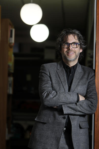 """FILE - This Dec. 6, 2010 file photo shows author Michael Chabon posings for a photo in New York. Chabon's """"Telegraph Avenue,"""" was named one of 2012's notable books by The New York Times. His first novel in five years, its release was one of the literary events of 2012. (AP Photo/Seth Wenig, file)"""