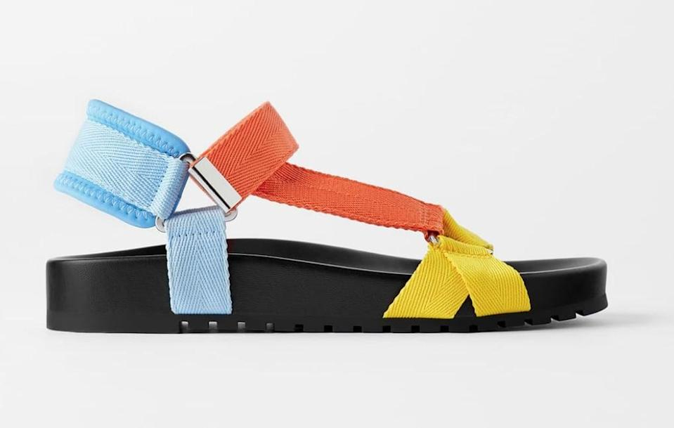 "<p>These sandals just make me happy.</p> <p><a href=""https://www.popsugar.com/buy/Zara-Multicolored-Flat-Slide-Sandals-555155?p_name=Zara%20Multicolored%20Flat%20Slide%20Sandals&retailer=zara.com&pid=555155&price=40&evar1=fab%3Aus&evar9=47446893&evar98=https%3A%2F%2Fwww.popsugar.com%2Fphoto-gallery%2F47446893%2Fimage%2F47463191%2FZara-Multicolored-Flat-Slide-Sandals&list1=sandals%2Cshoes%2Ctrends%2Csummer%2Cfashion%20shopping&prop13=api&pdata=1"" class=""link rapid-noclick-resp"" rel=""nofollow noopener"" target=""_blank"" data-ylk=""slk:Zara Multicolored Flat Slide Sandals"">Zara Multicolored Flat Slide Sandals </a> ($40) </p>"