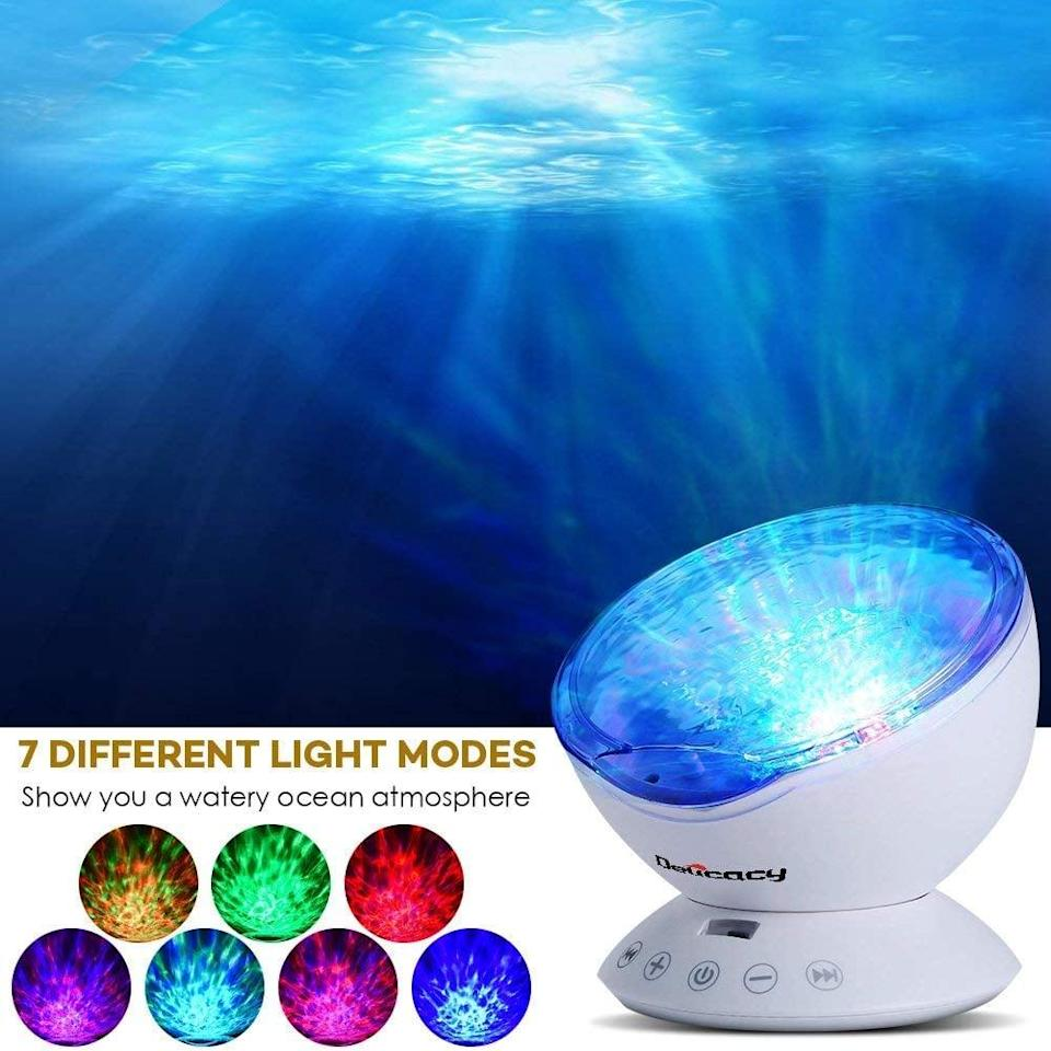 """<p>This <a href=""""https://www.popsugar.com/buy/Delicacy-Ocean-Wave-Projector-496536?p_name=Delicacy%20Ocean%20Wave%20Projector&retailer=amazon.com&pid=496536&price=25&evar1=geek%3Auk&evar9=42811495&evar98=https%3A%2F%2Fwww.popsugartech.com%2Fphoto-gallery%2F42811495%2Fimage%2F46721302%2FDelicacy-Ocean-Wave-Projector&list1=gifts%2Cgift%20guide%2Cgifts%20for%20men%2Cgifts%20under%20%24100%2Cgifts%20under%20%2450%2Cgifts%20under%20%2475&prop13=api&pdata=1"""" class=""""link rapid-noclick-resp"""" rel=""""nofollow noopener"""" target=""""_blank"""" data-ylk=""""slk:Delicacy Ocean Wave Projector"""">Delicacy Ocean Wave Projector</a> ($25) will help them sleep.</p>"""