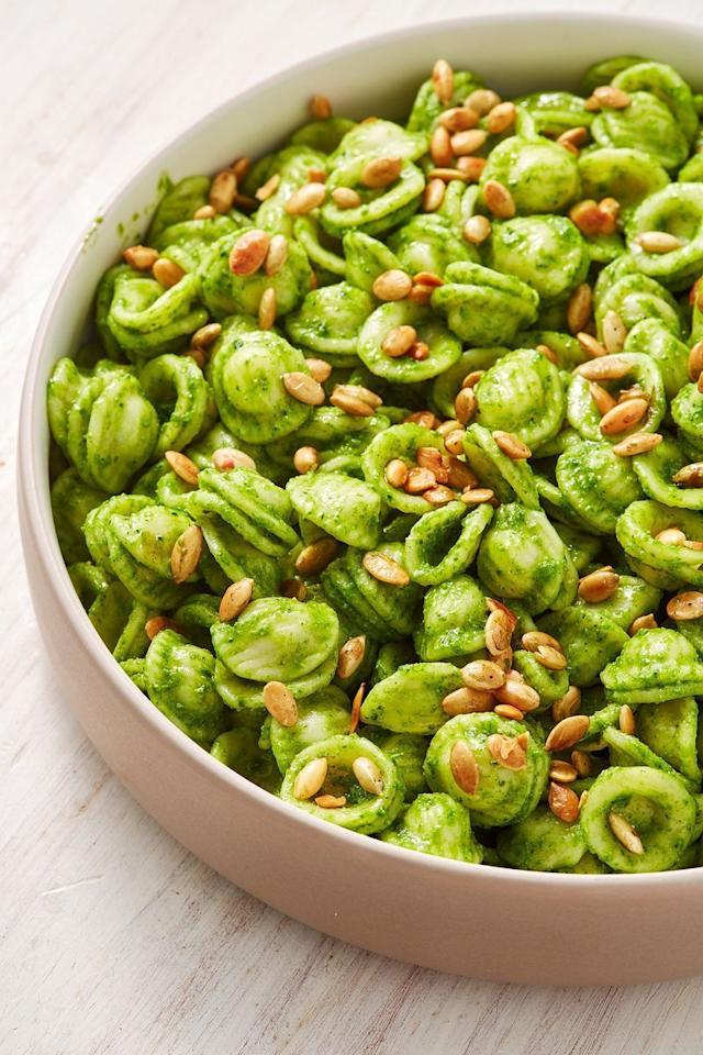"""<p>Pesto is great for a quick meal, but the jarred version never quite seems to retain the vibrant green colour and aroma of freshly blitzed, homemade pesto. Traditional <a href=""""https://www.delish.com/uk/cooking/recipes/a30379520/portobello-pesto-burgers-recipe/"""" target=""""_blank"""">pesto</a> usually uses basil, pine nuts and heaps of <a href=""""https://www.delish.com/uk/cooking/recipes/a29696085/brussels-sprouts-salad-recipe/"""" target=""""_blank"""">Parmesan</a>, so we've tried to make our version a little bit healthier, incorporating pumpkin seeds, kale and avocado instead (sorry to the Italians reading this!)</p><p>Get the <a href=""""https://www.delish.com/uk/cooking/recipes/a30271400/pesto-pasta/"""" target=""""_blank"""">Healthy Pesto Past</a>a recipe.</p>"""