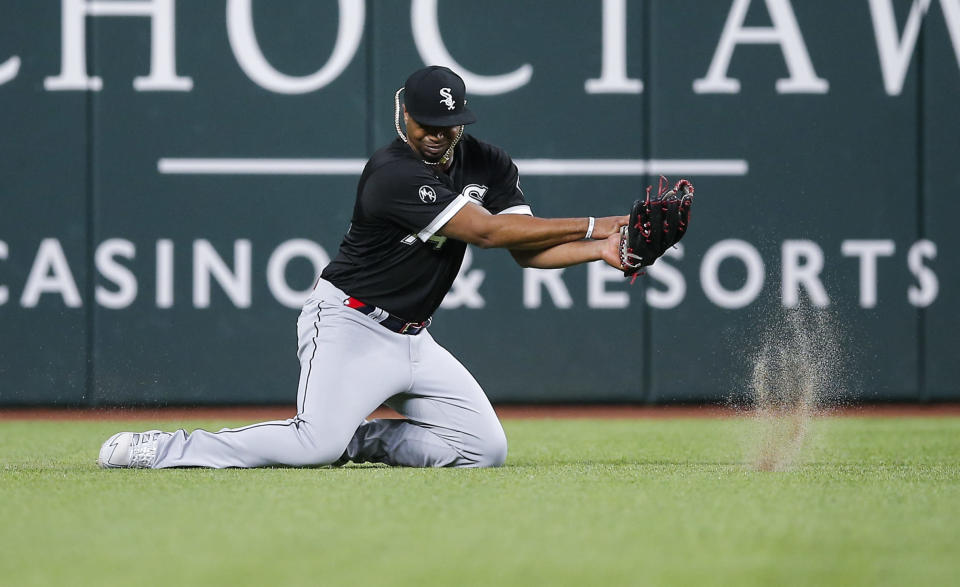 Chicago White Sox left fielder Eloy Jimenez fields a single by Texas Rangers' Nathaniel Lowe during the first inning of a baseball game, Saturday, Sept. 18, 2021, in Arlington, Texas. (AP Photo/Brandon Wade)