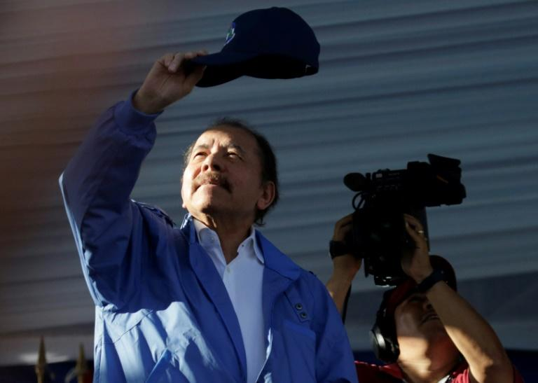 Nicaraguan President Daniel Ortega waves to supporters during a rally in Managua