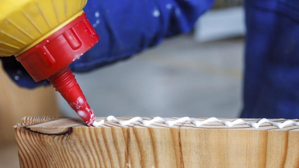 """If you plan on doing any remodeling or repair work on your home, be cautious of the type of adhesives you buy. The AVMA warns that polyurethane adhesives are found in many <a href=""""https://bestlifeonline.com/dangerous-household-items/?utm_source=yahoo-news&utm_medium=feed&utm_campaign=yahoo-feed"""" rel=""""nofollow noopener"""" target=""""_blank"""" data-ylk=""""slk:household products"""" class=""""link rapid-noclick-resp"""">household products</a>, and are dangerous if ingested by a dog. """"In particular, several brands of expanding wood glues—those containing diphenylmethane diisocyanate (often abbreviated as MDI)—have the potential to form obstructive gastrointestinal masses if ingested,"""" the AVMA warns on their website. """"The ingested adhesive can form an expanding ball of glue in your pet's esophagus and stomach, creating a firm mass that can be four to eight times the glue's original volume."""""""