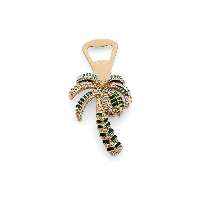 """Bring a touch of sparkle to cocktail hour with this embellished bottle opener. It's functional, decadent, and a serious showpiece. $80, One King's Lane. <a href=""""https://www.onekingslane.com/p/4781210-palm-tree-bottle-opener-gold-green.do?"""" rel=""""nofollow noopener"""" target=""""_blank"""" data-ylk=""""slk:Get it now!"""" class=""""link rapid-noclick-resp"""">Get it now!</a>"""