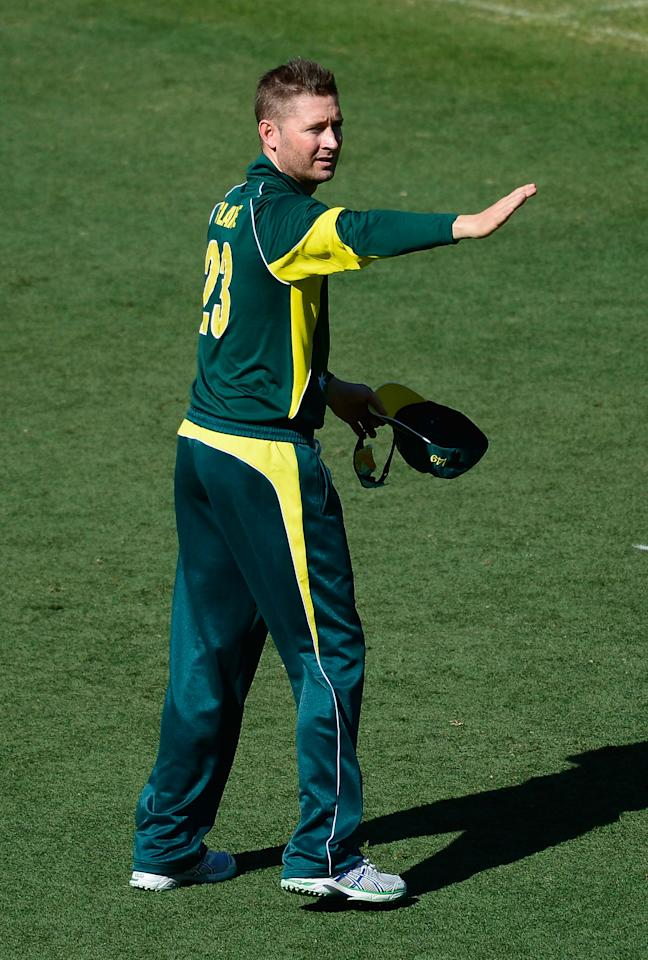 BRISBANE, AUSTRALIA - JANUARY 17:  Michael Clarke of Australia signals to a team mate during the second game of the One Day International Series between Australia and England at The Gabba on January 17, 2014 in Brisbane, Australia.  (Photo by Ian Hitchcock/Getty Images)