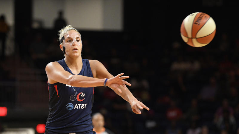 Washington Mystics forward Elena Delle Donne (11) passes the ball during the first half of an WNBA basketball game against the Seattle Storm, Wednesday, Aug. 14, 2019, in Washington. (AP Photo/Nick Wass)
