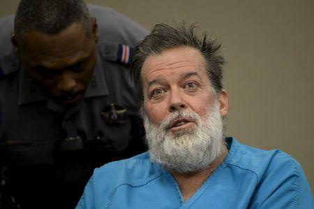 A deputy tries to calm Robert Lewis Dear, 57, accused of shooting three people to death and wounding nine others at a Planned Parenthood clinic in Colorado last month, as he spoke out at his hearing at an El Paso County court in Colorado Springs