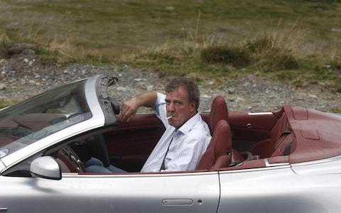 Clarkson with a fag in a Jag
