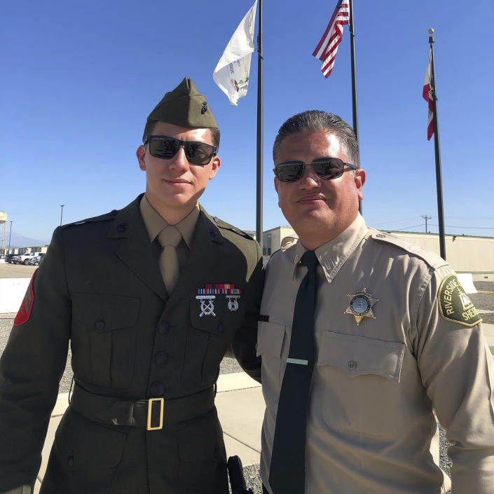 This undated photo released by the Riverside County Sheriff's Department shows U.S. Marine Corps Cpl. Hunter Lopez, 22, left, with his father Capt. Herman Lopez in Riverside, Calif. U.S. Marine Corps Cpl. Hunter Lopez, of Indio, Calif., was killed on Aug. 26, in the bomb attacks in Kabul, Afghanistan. Cpl. Lopez, whose parents work at the Riverside County Sheriff's Department in Southern California, was a sheriff's Explorer for three years before joining the Marine Corps in September 2017, Sheriff Chad Bianco said. Bianco said Lopez planned to follow in his parents' footsteps and become a Riverside County Sheriff's Deputy after his deployment. (Riverside County Sheriff's Department via AP)