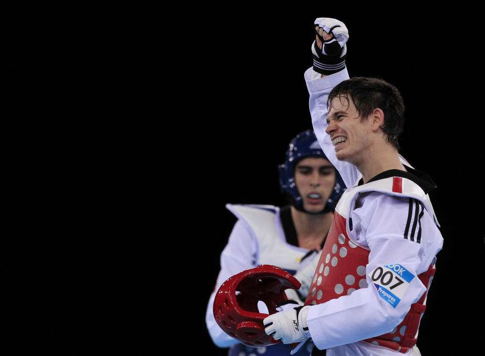 Walkden's long-time boyfriend, Aaron Cook, is also one of the sport's most famous fighters (Picture: Reuters)